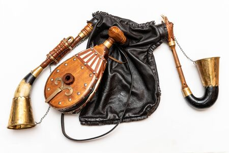 Bagpipes, a traditional musical instrument. Bagpipes are a woodwind musical instrument from the group of reed aerophones (pipe aerophone). Close-up and white background.