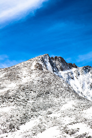 mount evans: beautiful scenic view of the snow capped mountain peaks on the summit of Mt Evans. Mount Evans is one of the top travel vacation spots in the USA featuring the highest paved road in the northern hemisphere and is located near Denver Colorado. Stock Photo