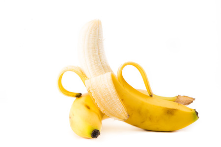 bannana: A single Bannana peeled down, ready to eat on a isolated on a white background Stock Photo