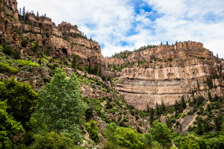 Rocky cliff seen from inside Glenwood Canyon near Hanging Lake. Hanging Lake is a national park and popular tourist location for those on vacation near Glenwood Springs Colorado. Stock Photo