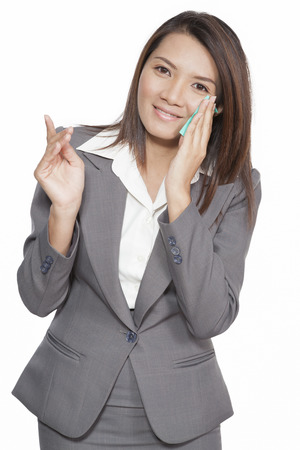 asian model: business women beautiful young pretty Asian model brunette using facial tissue smilling positive dress suit on white background