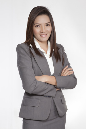 smilling: Portrait of a young attractive business woman executive beautiful pretty positive smilling suit