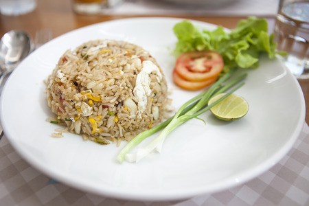 crabmeat: Thai food lunchtime dish of Thai rice, Fried rice with crabmeat and mix onion, egg, tomato, and scallion  Stock Photo