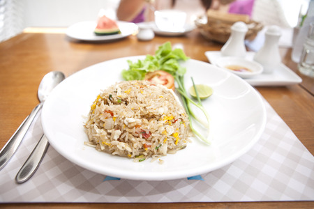 crabmeat: Thai food lunchtime dish of Thai rice, Fried rice with crabmeat and mix onion, egg, tomato, and  scallion