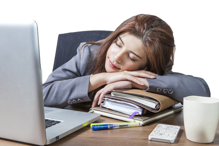 Business woman sleeping on laptop taking a power nap during work Isolated photo