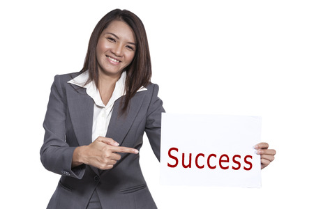 Happy smiling young pretty attractive brunette Asian business woman standing positive showing success signboard, isolated on white background photo
