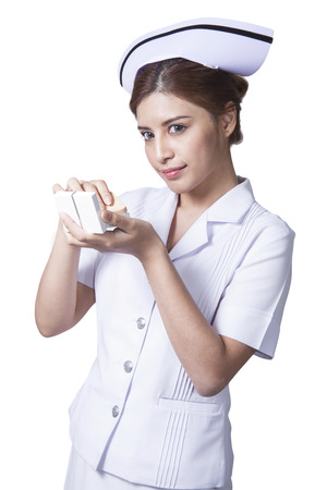 Young woman asian nurse attractive beauty brunette holding face powder for make up in white background Stock Photo - 29205839