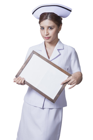 ady: Young woman asian nurse attractive beauty brunette showing white singboard in white background