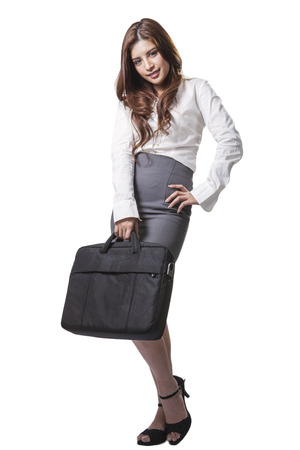 full length brunette businesswoman holding handbag  isolated on white background photo
