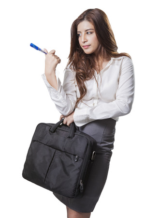 Beautiful brunette businesswoman holding handbag isolated on white background photo