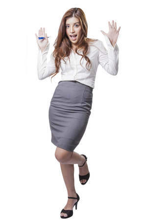 Brunette beauty businesswoman excited surprised woman holding her head in surprise  Isolated on white background  photo