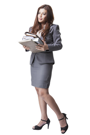 Full length businesswoman holding documents and notebook isolated on white back ground photo