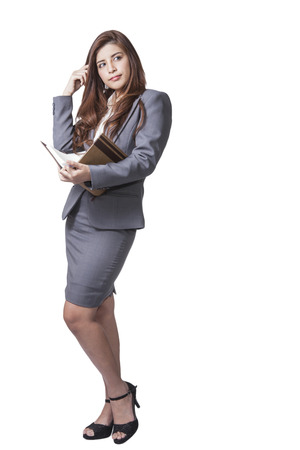 ponder: Business woman attractive young pretty in office standing enjoy using a pen writing diary note book ponder positive on white background