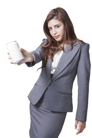 beer can: Young brunette businesswoman presenting a can of soft drink, focus at a can isolated on white background