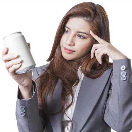 Young attractive businesswoman shop round a can of soft drink isolated on white background  Stock Photo