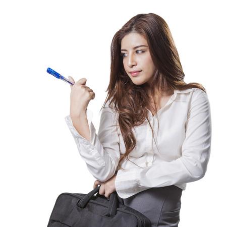 Beautiful brunette businesswoman holding handbag isolated on white background photo
