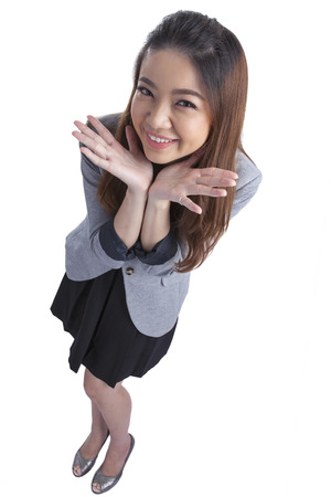 Funny Businesswoman shrugging isolated on white  Asian-Caucasian young xwoman with her palms out showing doubt in a full length isolation from a high angle view  photo