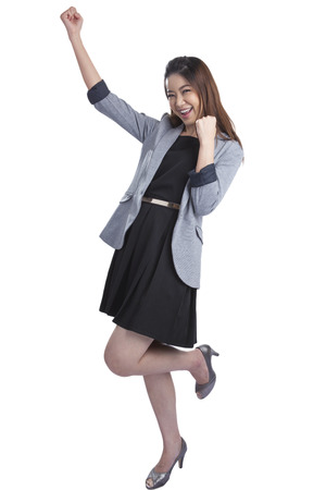 Successful young business xwoman happy for her success  Isolated full body image on white background  Mixed Asian   Caucasian businesswoman  photo