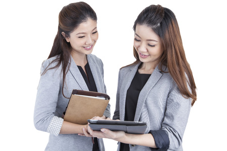 Two beautiful businesswomen working in white background photo