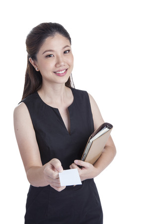 Business card woman.  Portrait of a young beautiful businesswoman holding a blank white paper sign  Mixed race chinese   caucasian xwoman isolated on seamless white background  photo