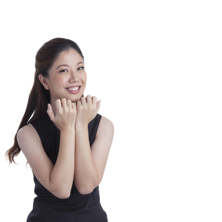 Nervous scared xwoman biting her nails. Funny asian businesswoman isolated in full length on white background. Mixed caucasian  chinese model. photo