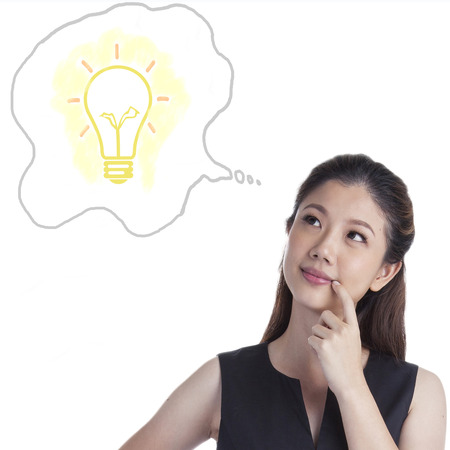 Thinking business xwoman standing pensive contemplating looking up for inspiration. Beautiful multi-racial Caucasian / Asian businesswoman isolated on white background.