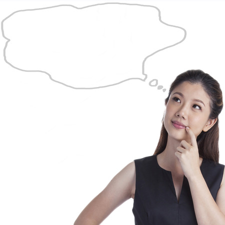 chinese woman: Woman thinking blackboard concept. Pensive girl looking at thought bubble on chalkboard  blackboard texture background. Mixed race Asian Chinese  Caucasian student. Stock Photo