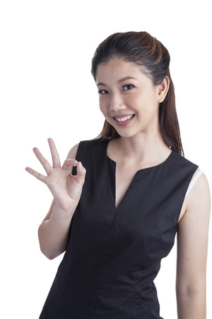 ok sign: Perfect - business xwoman showing OK hand sign smiling happy. Young pretty Asian  Caucasian businesswoman isolated on white background.