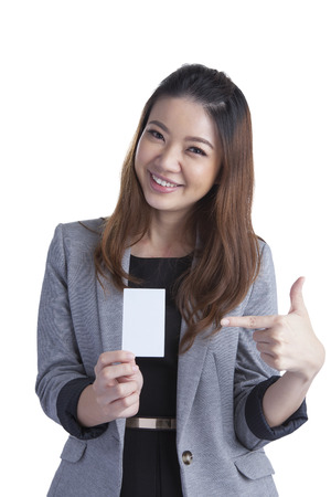 Business card woman  Portrait of a young beautiful businesswoman holding a blank white paper sign  Mixed race chinese   caucasian xwoman isolated on seamless white background  photo