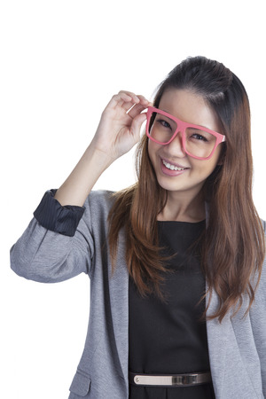 chinese sex: Eyewear glasses xwoman happy holding showing her new glasses smiling on white background  Beautiful young multiethnic Asian Chinese   Caucasian female model in her twenties  Stock Photo