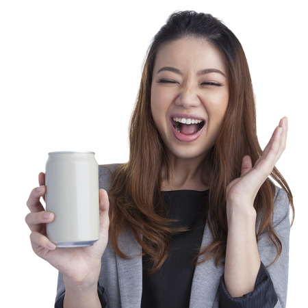 beer can: Full length young business woman pretty beautiful attractive cheerful presenting grey a can of soft drink on white background