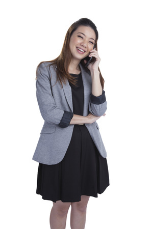 chinese sex: Young businesswoman talking on mobile phone  Beautiful young multiracial Chinese Asian   caucasian xwoman talking on her cellphone  Isolated on white background