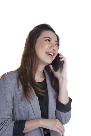 Young businesswoman talking on mobile phone  Beautiful young multiracial Chinese Asian   caucasian xwoman talking on her cellphone  Isolated on white background  photo