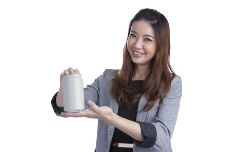 asian woman face: Young brunette businesswoman presenting a can of soft drink isolated on white background