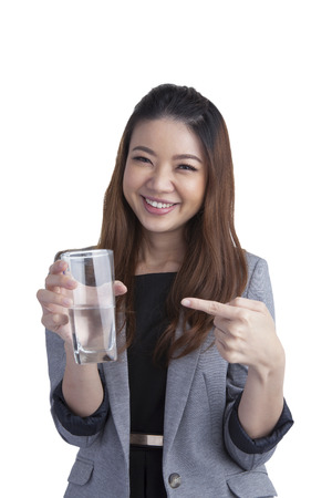 acqua bicchiere: Young businesswoman showing water on water glass isolated on white background