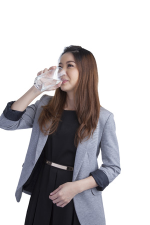 Young businesswoman drinking water on water glass isolated on white background  photo