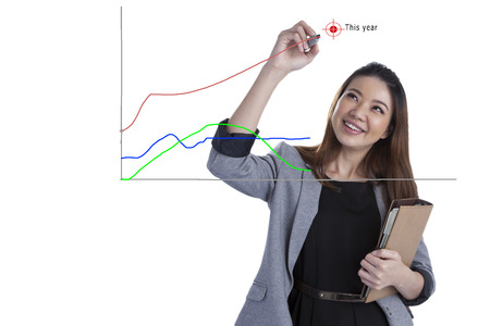 Business success growth chart  Business xwoman drawing graph showing profit growth on virtual screen  Asian businesswoman isolated on white background in suit  photo