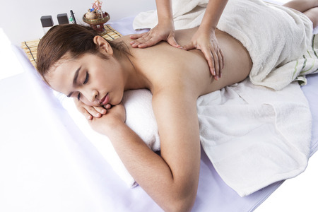 Young woman receiving professional massage  photo
