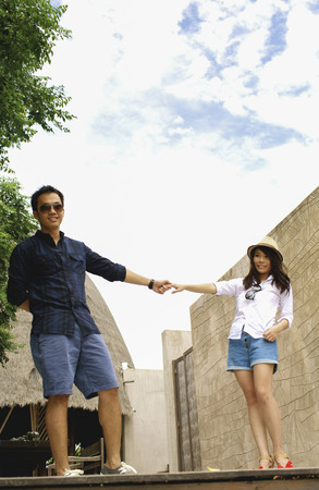 Romantic young couple  hold ones hands each other in resort on beauty beach photo