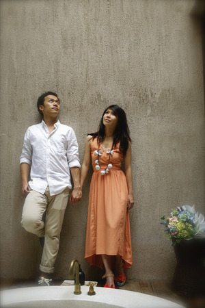 Romantic young couple  hold ones hands each other in bathroom on vintage resort  the beach Thailand. photo