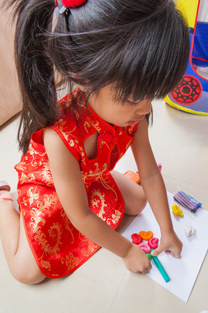 child's play clay: Little girl creating toys from playdough Stock Photo
