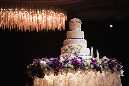 wedding table decor: Wedding cake decorated with flowers