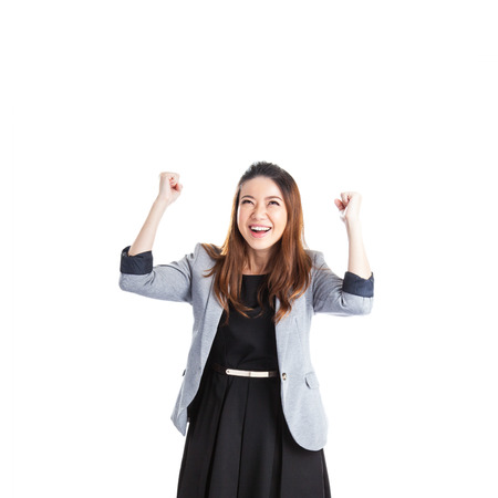 Successful young business xwoman happy for her success. Isolated full body image on white background.  photo