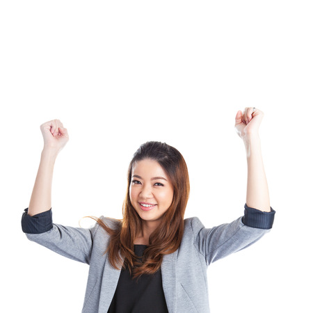 Successful young business xwoman happy for her success. Isolated full body image on white background. Mixed Asian businesswoman. photo