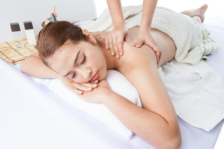 Young woman receiving professional massage. photo