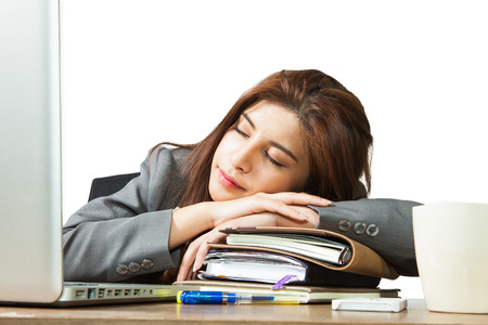 Business woman sleeping on laptop taking a power nap during work Isolated