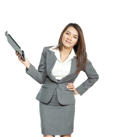 smilling: Portrait young pretty businesswoman in office attractive standing using a tablet smilling and happiness