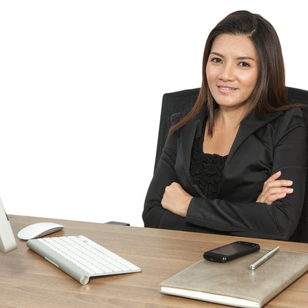 Young business woman attractive with laptop working on table in office photo