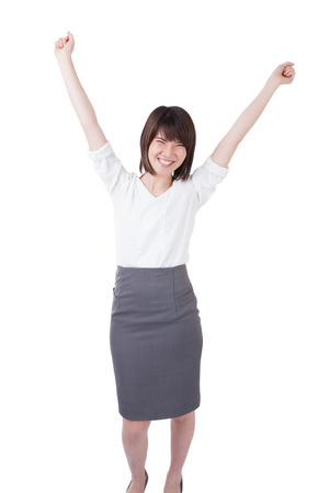 body image: Successful young businesswoman happy for her success. Isolated full body image on white background. Mixed Asian  Caucasian businesswoman.