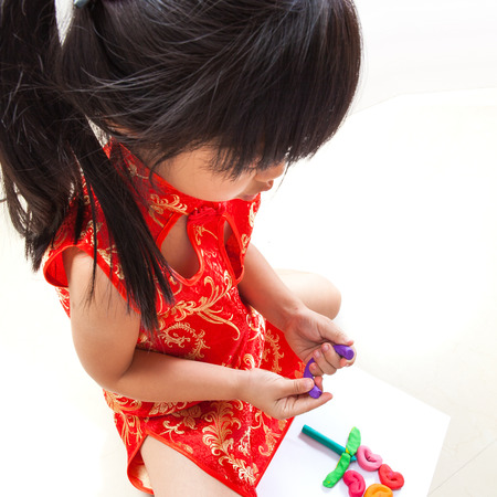 playdoh: Little girl creating toys from playdough Stock Photo